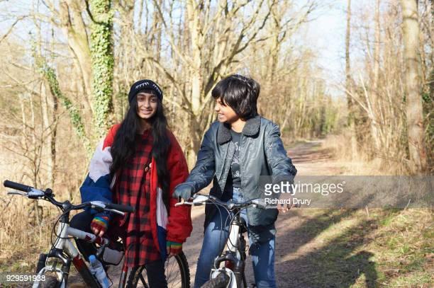 Teenage girls talking on cycle track
