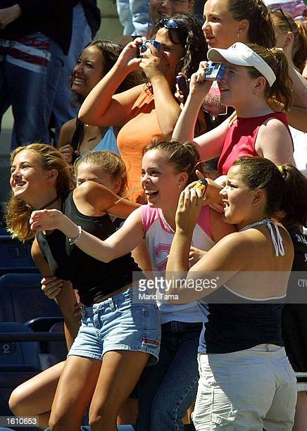 Teenage girls try to get a glimpse of the band OTown as they perform during Arthur Ashe Kids'' Day August 25 2001 at the USTA National Tennis Center...