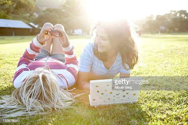 Teenage girls using communication technology