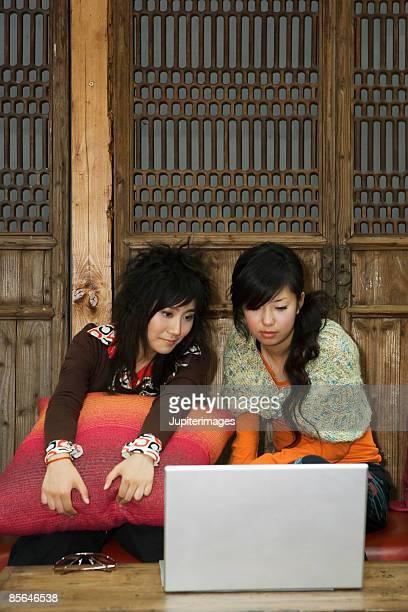 Teenage girls using laptop computer