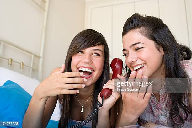 Teenage girls using telephone
