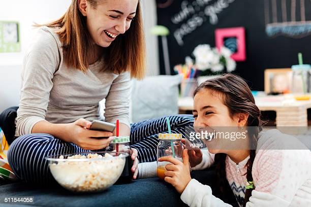Teenage Girls Using Their Smart Phones.
