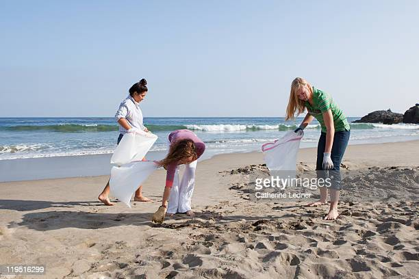 Teenage Girls Volunteering Beach Cleanup