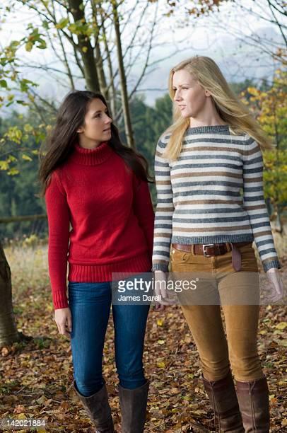 Teenage girls walking in park