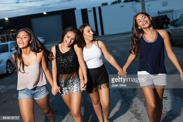 teenage girls walking on the street - alleen tienermeisjes stockfoto's en -beelden