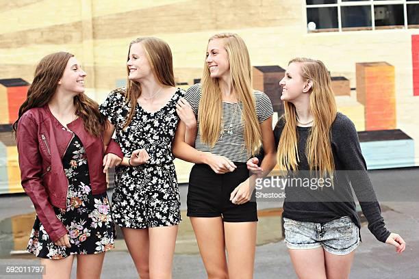 Teenage girls walking outdoors