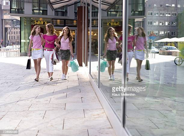 Teenage girls (16-17) walking with shopping bag