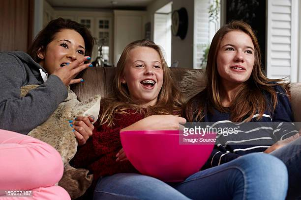 teenage girls watching movie with popcorn - girlfriends films stock pictures, royalty-free photos & images