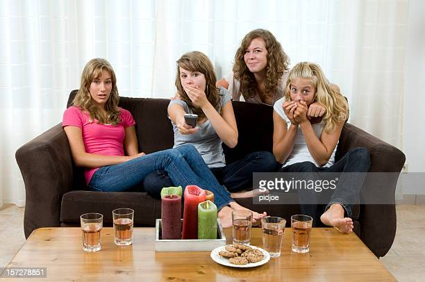teenage girls watching television