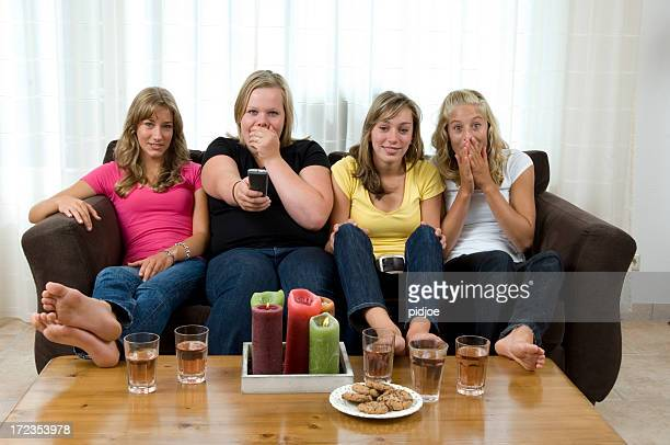 teenage girls watching tv