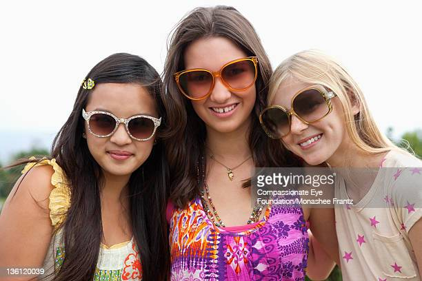 teenage girls wearing sunglasses in garden - cef do not delete stock pictures, royalty-free photos & images