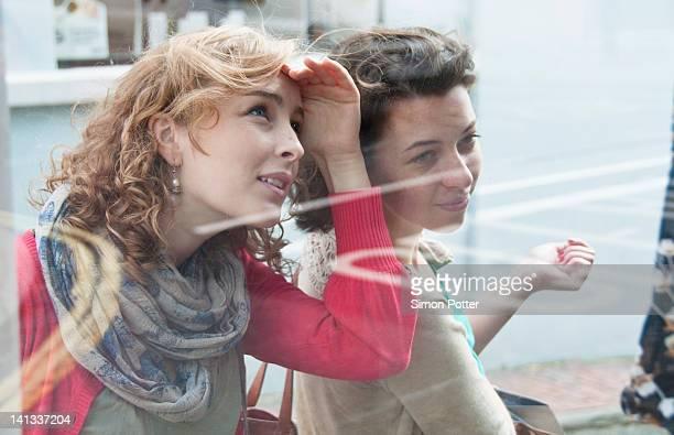 Teenage girls window shopping together