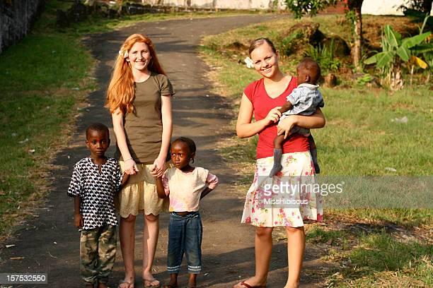 Teenage girls with African children