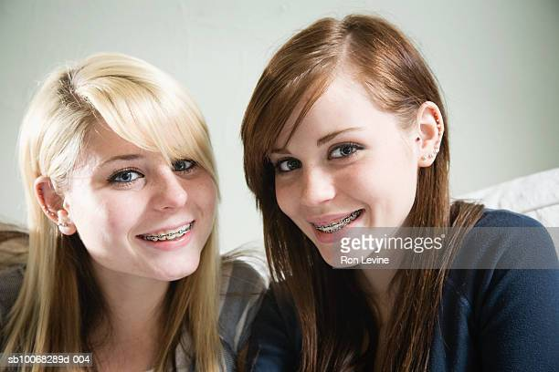 teenage girls (14-15) with braces, smiling, portrait, close-up - only teenage girls stock pictures, royalty-free photos & images
