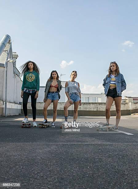 teenage girls with skateboards
