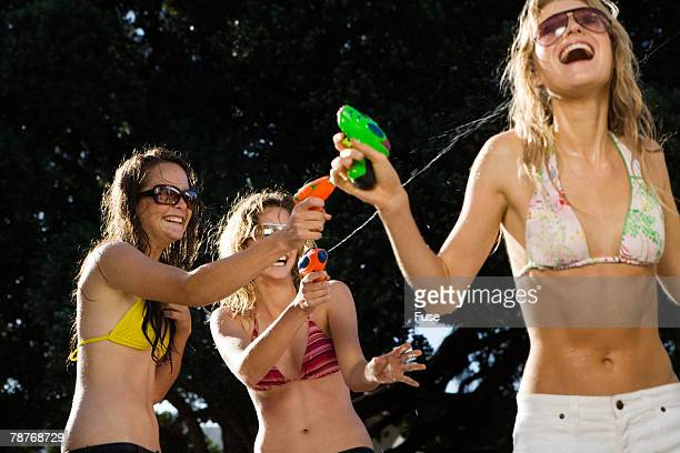 teenage girls with squirt guns - teenagers only stock pictures, royalty-free photos & images