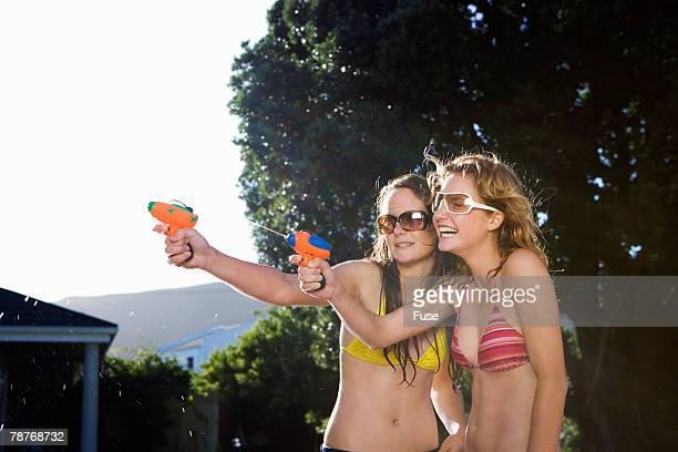 Teenage Girls with Squirt Guns