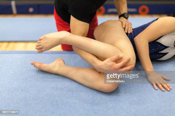 teenage gymnastics athlete receiving physical therapy - daily sport girls stock pictures, royalty-free photos & images