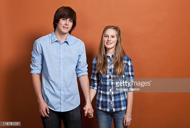 A teenage, heterosexual couple, portrait, studio shot