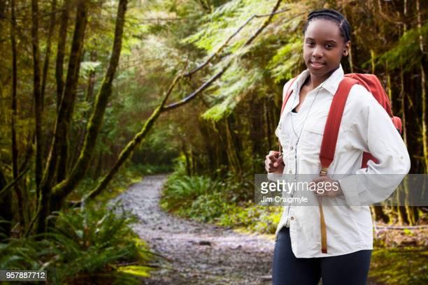 Teenage hiker in rain forest. Port Renfrew, Vancouver Island
