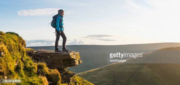 teenage hiker on mountain ridge overlooking wilderness panorama to horizon - brecon beacons stock pictures, royalty-free photos & images