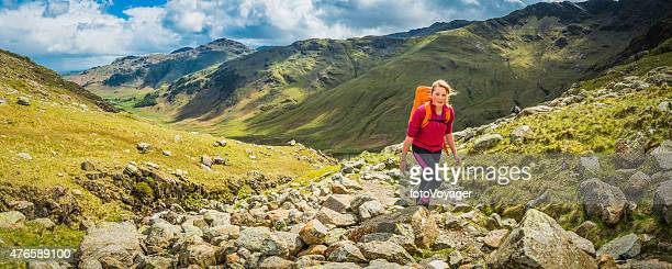 Teenage hiker walking picturesque mountain trail panorama Lake District Cumbria