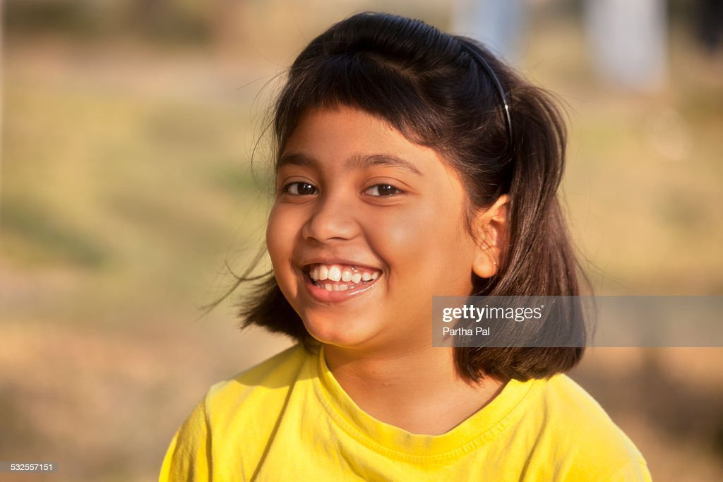 a teenage indian girl in merry mood ストックフォト getty images
