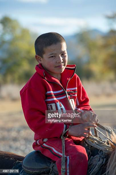 A teenage Kazakh boy is riding a horse near the city of Ulgii in the BayanUlgii Province in western Mongolia