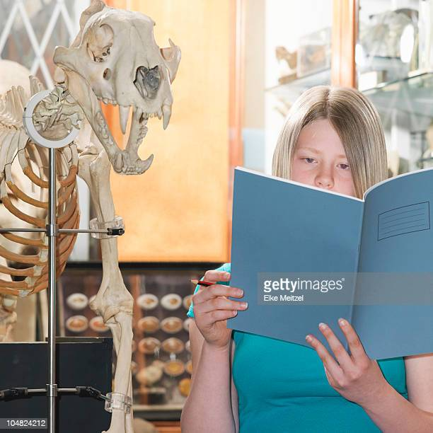 Teenage looking at exercise book