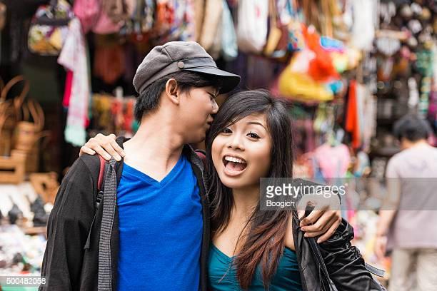 Teenage Love Young Balinese Couple in Ubud Market Indonesia