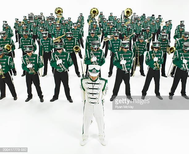 Teenage (14-18) marching band standing in rows, elevated view