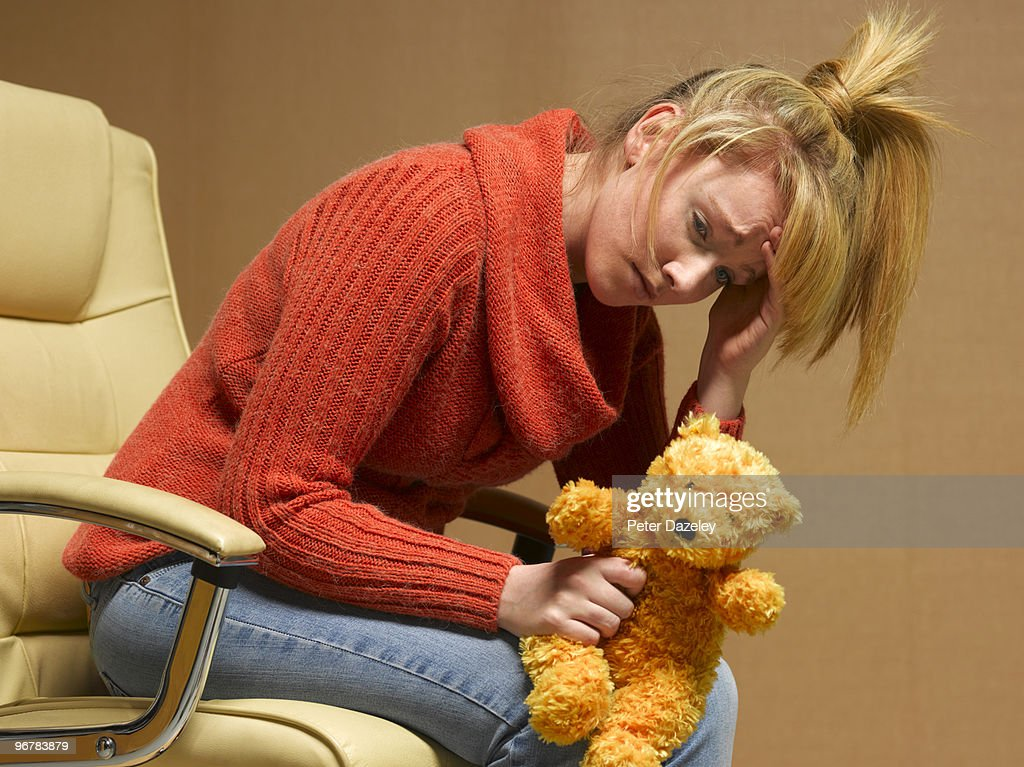 Teenage mother with depression : Stock Photo