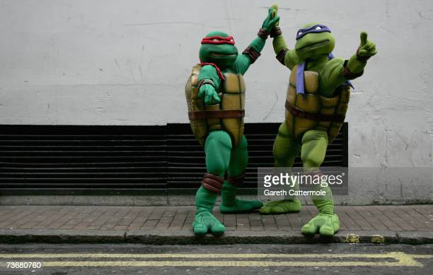 Teenage Mutant Ninja Turtles Raphael and Donatello pose outside Hamleys toy store on March 23 2007 in London England The turtles were in town to...