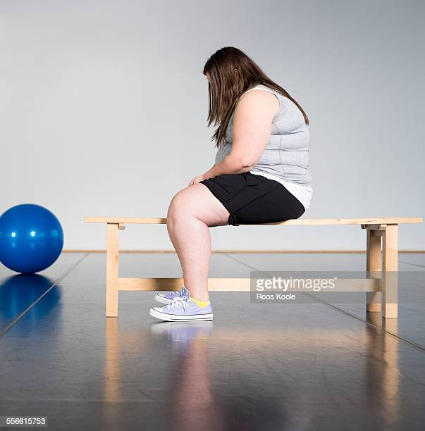 teenage overweight girl in gym - fat girls stock photos and pictures