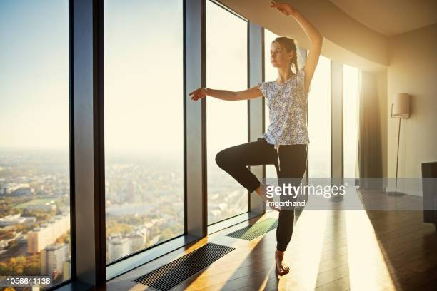teenage practicing dancing at modern apartment - practicing stock photos and pictures