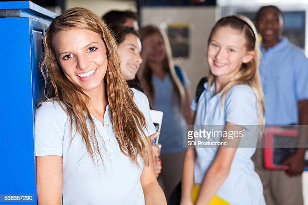 teenage private school student in hallway - cute highschool girls stock photos and pictures
