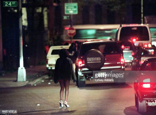 A teenage prostitute wades through traffic while looking for customers in Long Island City Queens New York City on May 1 1999 Dozens of prostitutes...