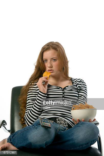 teenage redhead eating crisps - barefoot redhead stock photos and pictures