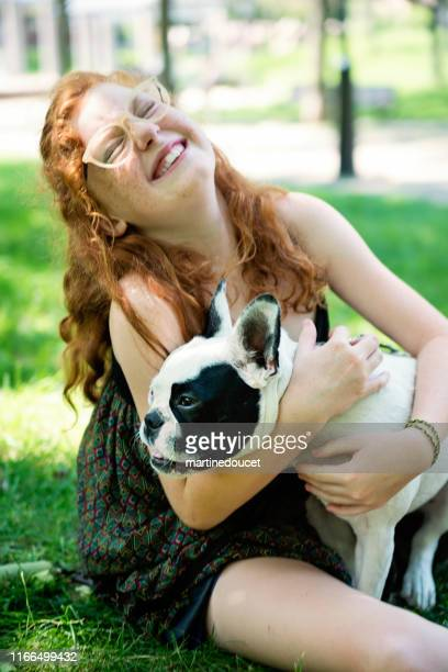 """teenage redhead girl in a park with a dog - """"martine doucet"""" or martinedoucet stock pictures, royalty-free photos & images"""