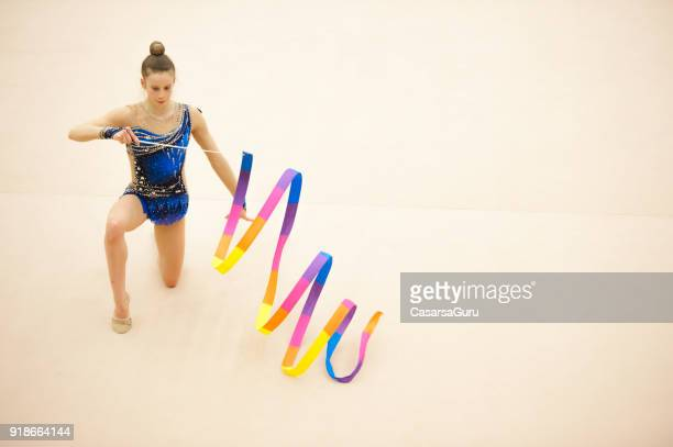 Teenage Rhythmic Gymnastics Athlete Doing Ribbon Routine
