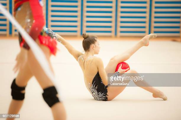 teenage rhythmic gymnastics athletes practicing - rhythmic gymnastics stock pictures, royalty-free photos & images