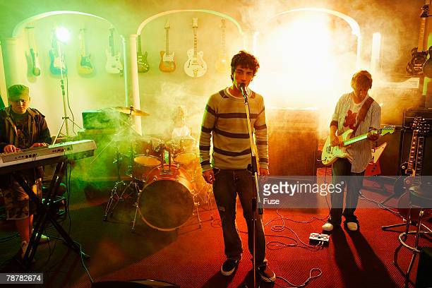 teenage rock band performing - rock band stock photos and pictures