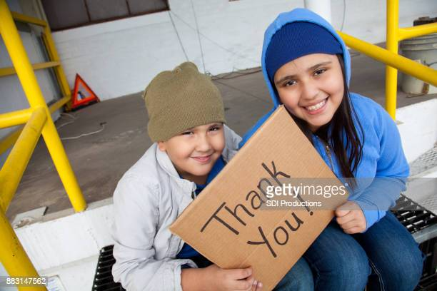 teenage runaways are thankful for help - orphan stock pictures, royalty-free photos & images