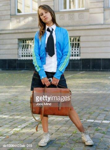 a12c77035b Teenage Schoolgirl Posing In Front Of School Building Portrait Stock Photo  - Getty Images