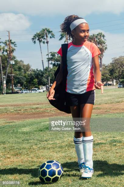 teenage schoolgirl soccer player on school sports field - school girl shoes stock pictures, royalty-free photos & images