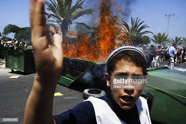 A teenage settler gestures as Israeli police clash with antidisengagement activists trying to prevent the entry of shipping containers August 16 2005...