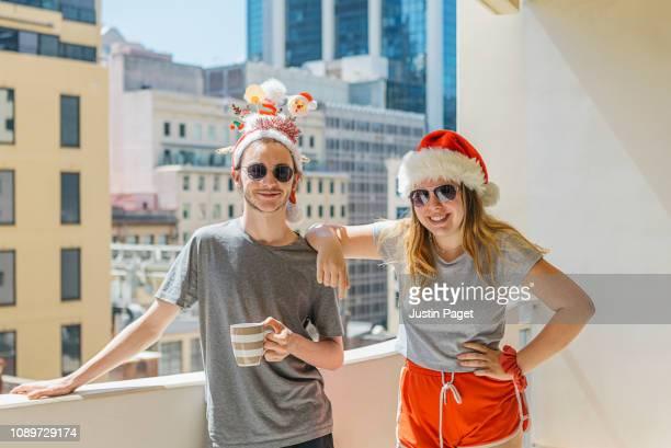 Teenage siblings in christmas hats