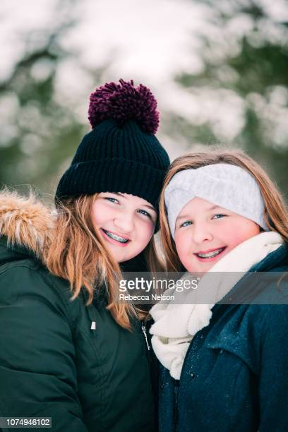 teenage sisters outdoors on winter day - rebecca nelson stock pictures, royalty-free photos & images