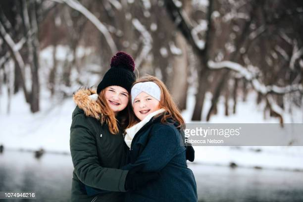 teenage sisters outdoors on winter day
