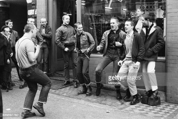 Teenage Skinheads dancing the Moonstomp outside a shop in London. 29th March 1980.